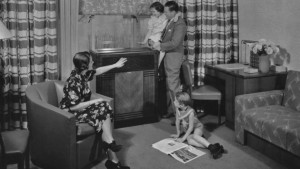 A mother and father and their two young children gather in the living room around their new Carrier air conditioning unit in the 1940's. (Photo by Archive Photos/Getty Images)